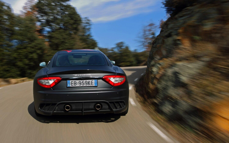 http://st.automobilemag.com/uploads/sites/10/2015/09/2012-maserati-granturismo-MC-stradale-rear-end-in-motion.jpg