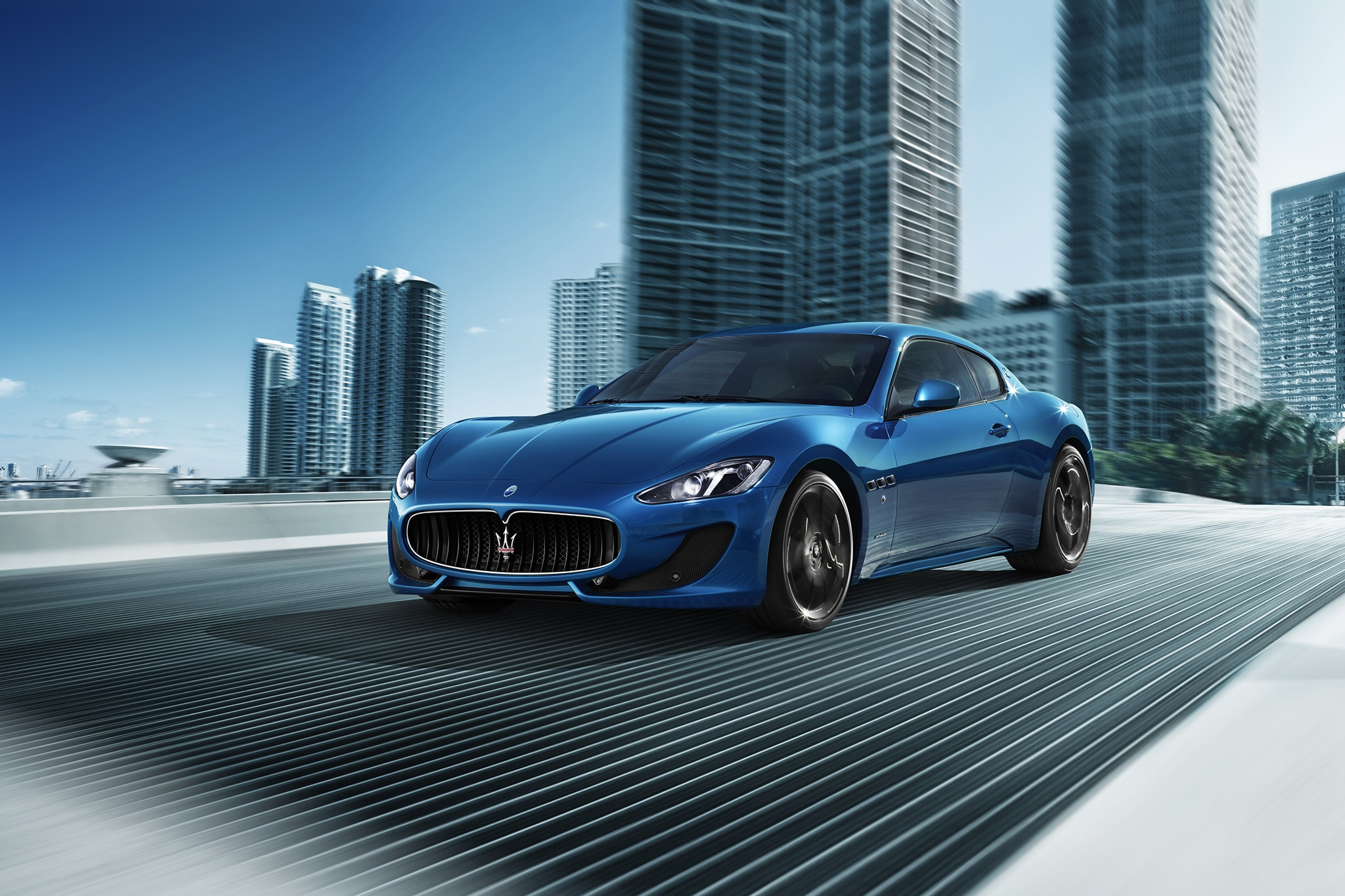http://st.automobilemag.com/uploads/sites/10/2015/09/2013-Maserati-GranTurismo-Sport-front-drivers-side-view-in-motion.jpg