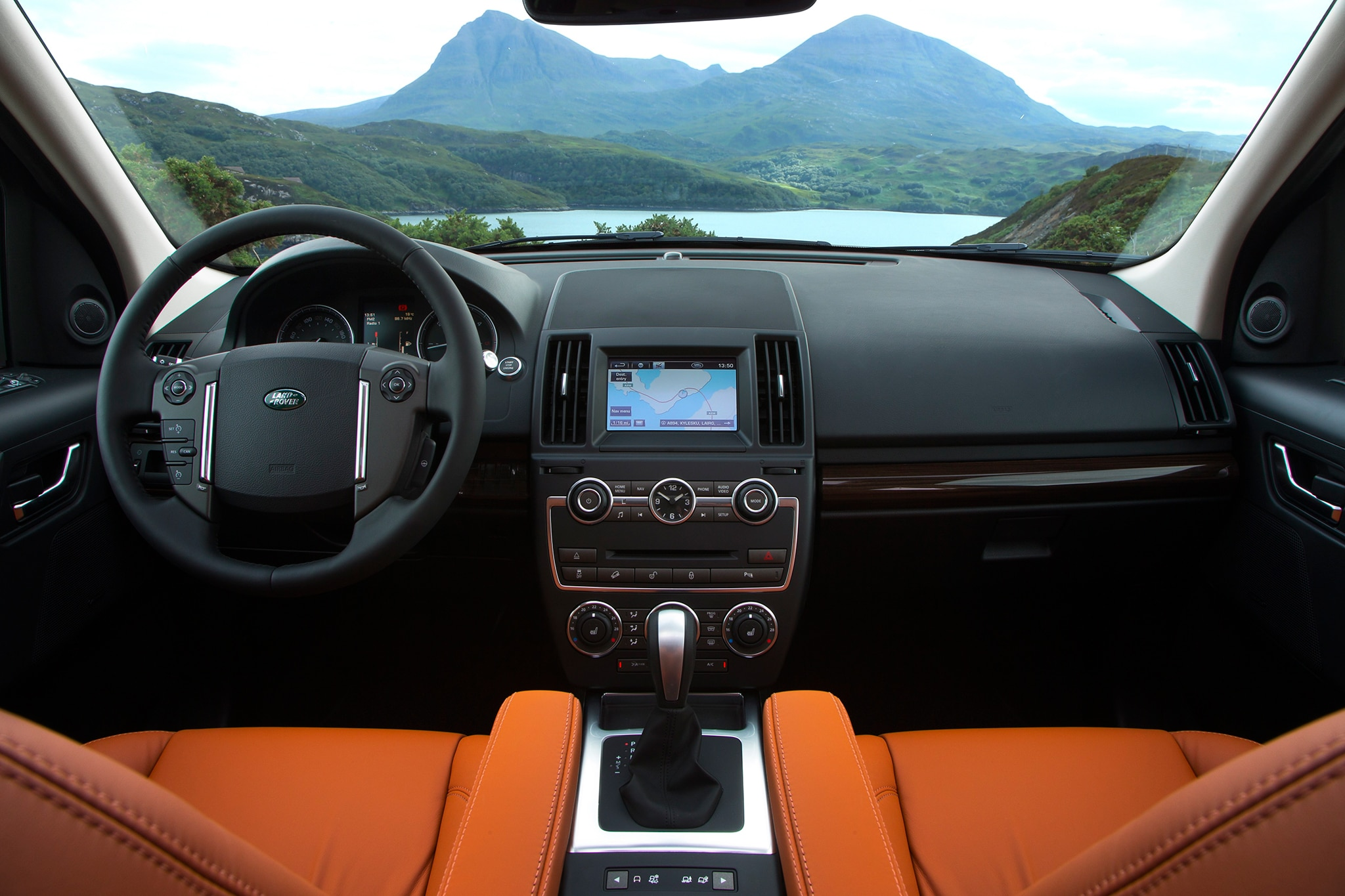 http://st.automobilemag.com/uploads/sites/10/2015/09/2013-land-rover-LR2-front-interior-view.jpg
