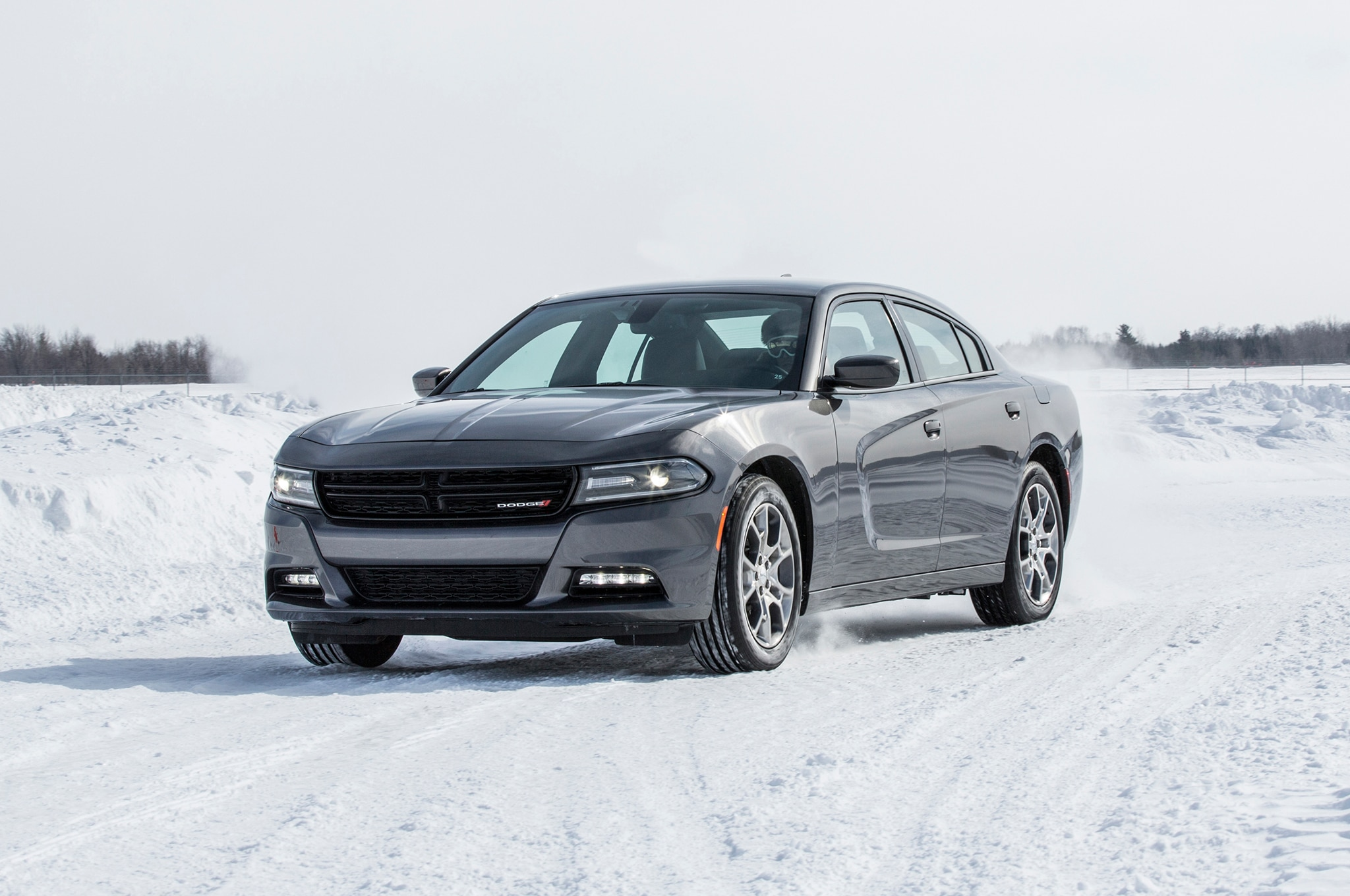 2015 dodge charger sxt awd front three quarter in motion 02. Black Bedroom Furniture Sets. Home Design Ideas