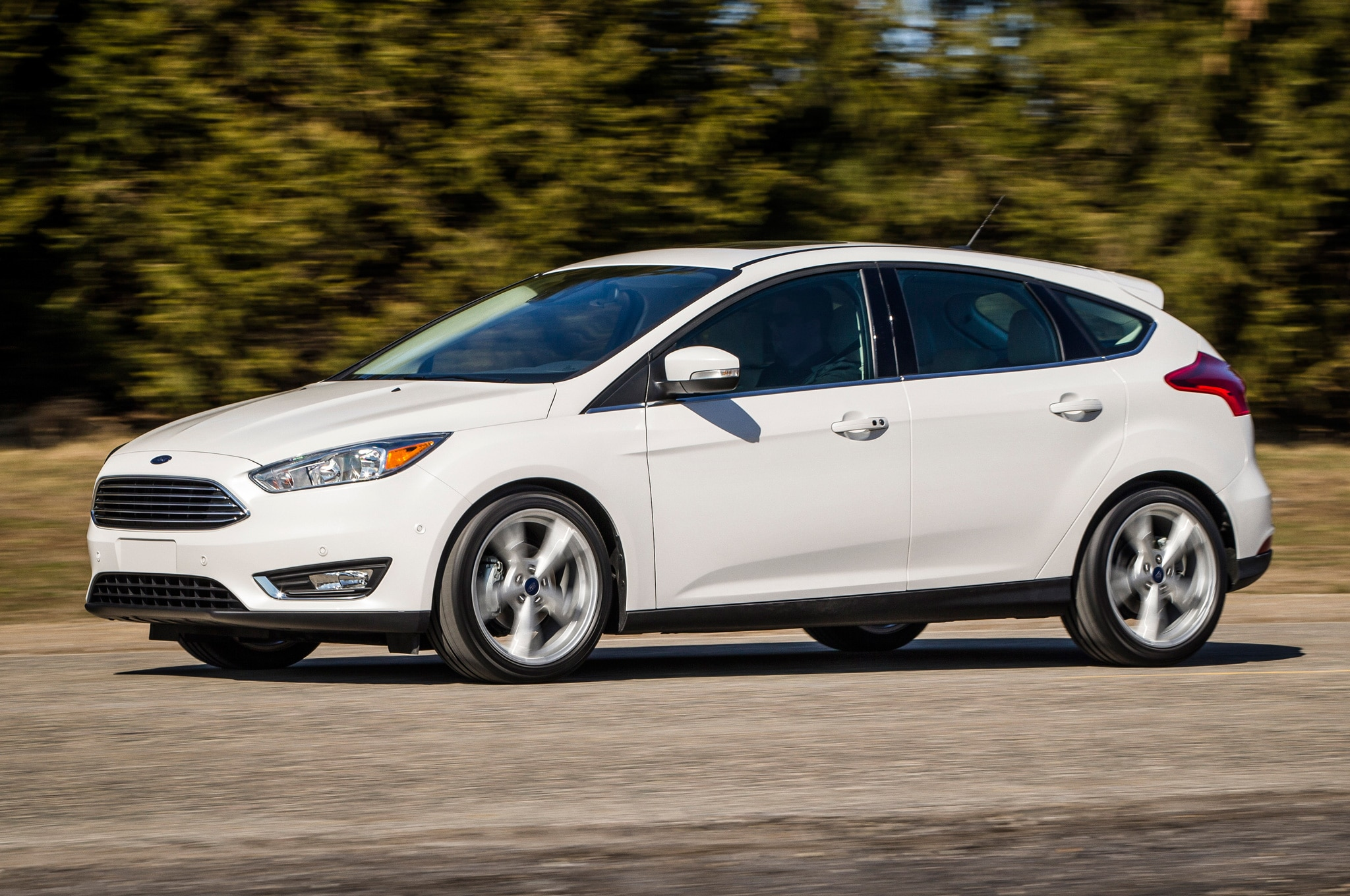 2015 ford focus hatchback front side motion view on road - Ford Focus 2014 Hatchback White