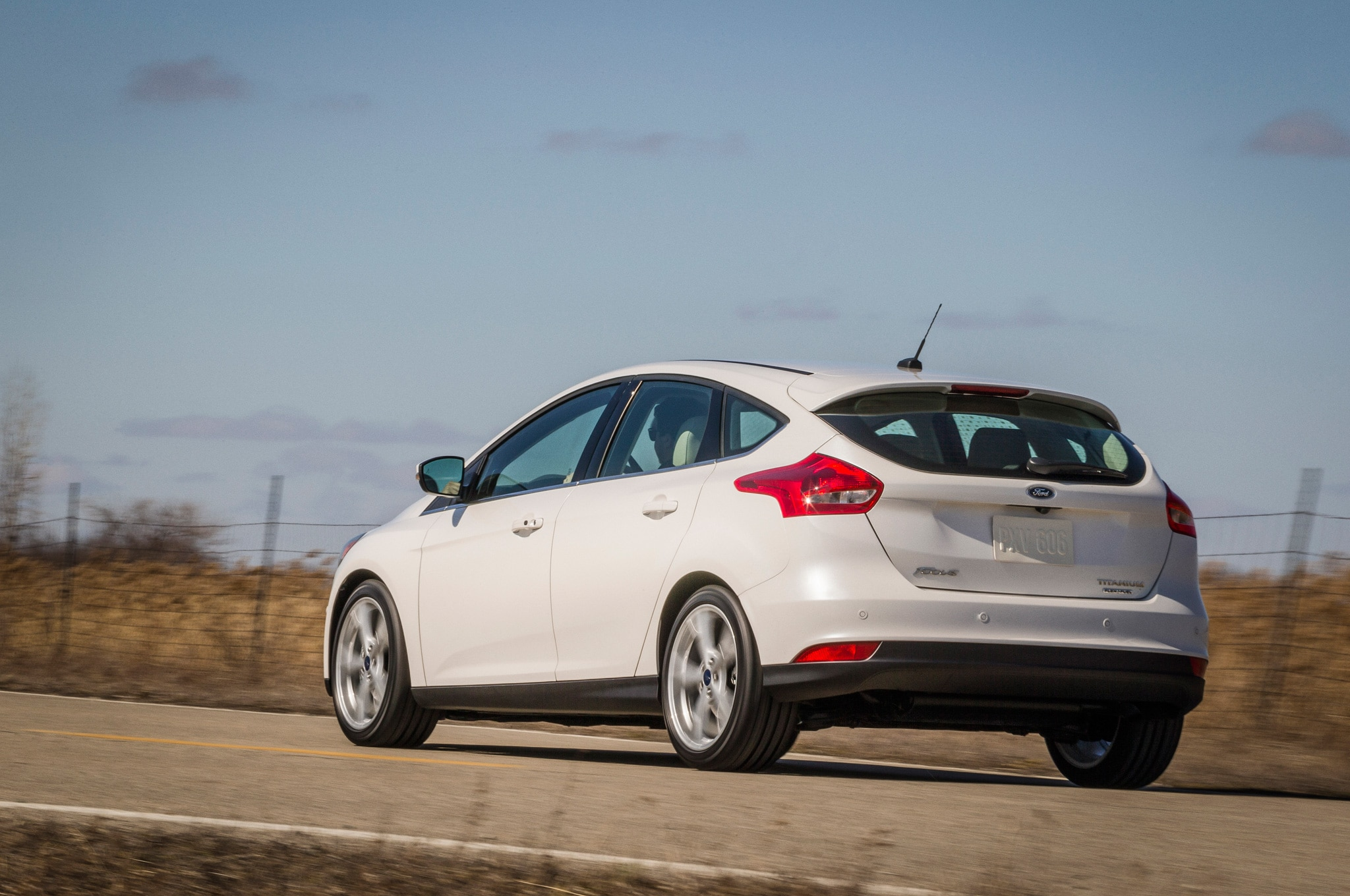 2015 ford focus hatchback rear side motion view