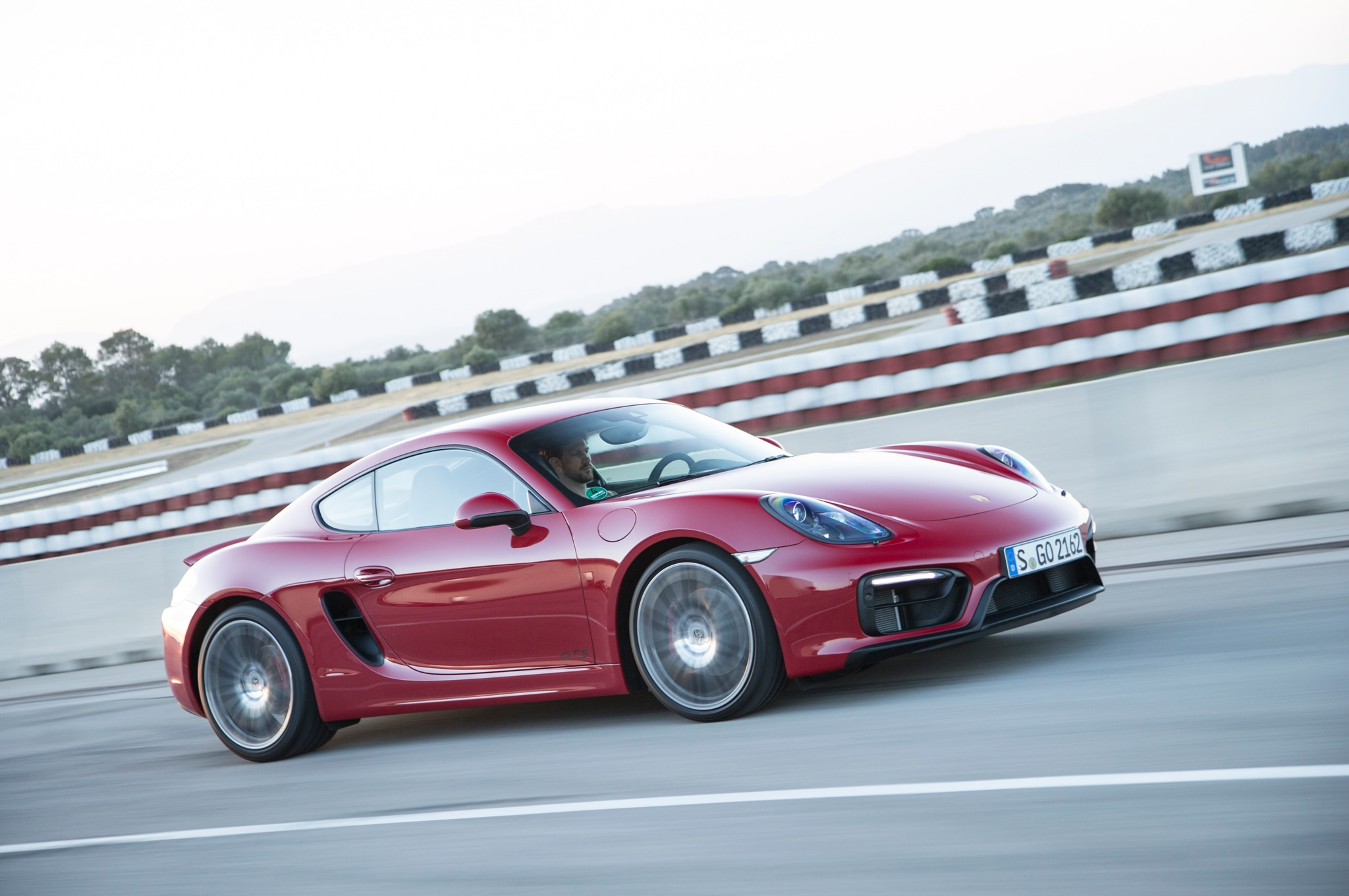 watch the 2015 porsche cayman gts shred a go-kart track