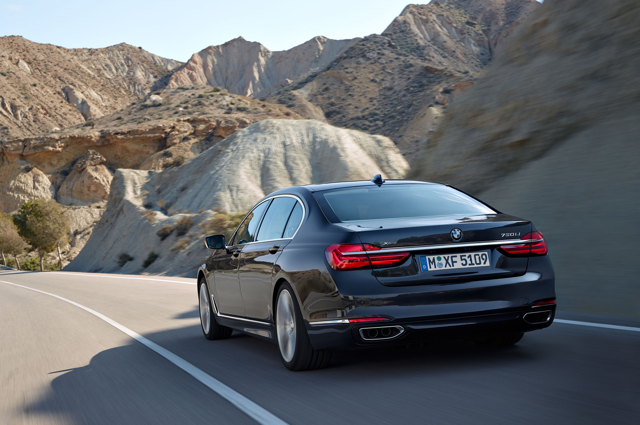 2016 BMW 750Li XDrive Rear Three Quarter In Motion 02