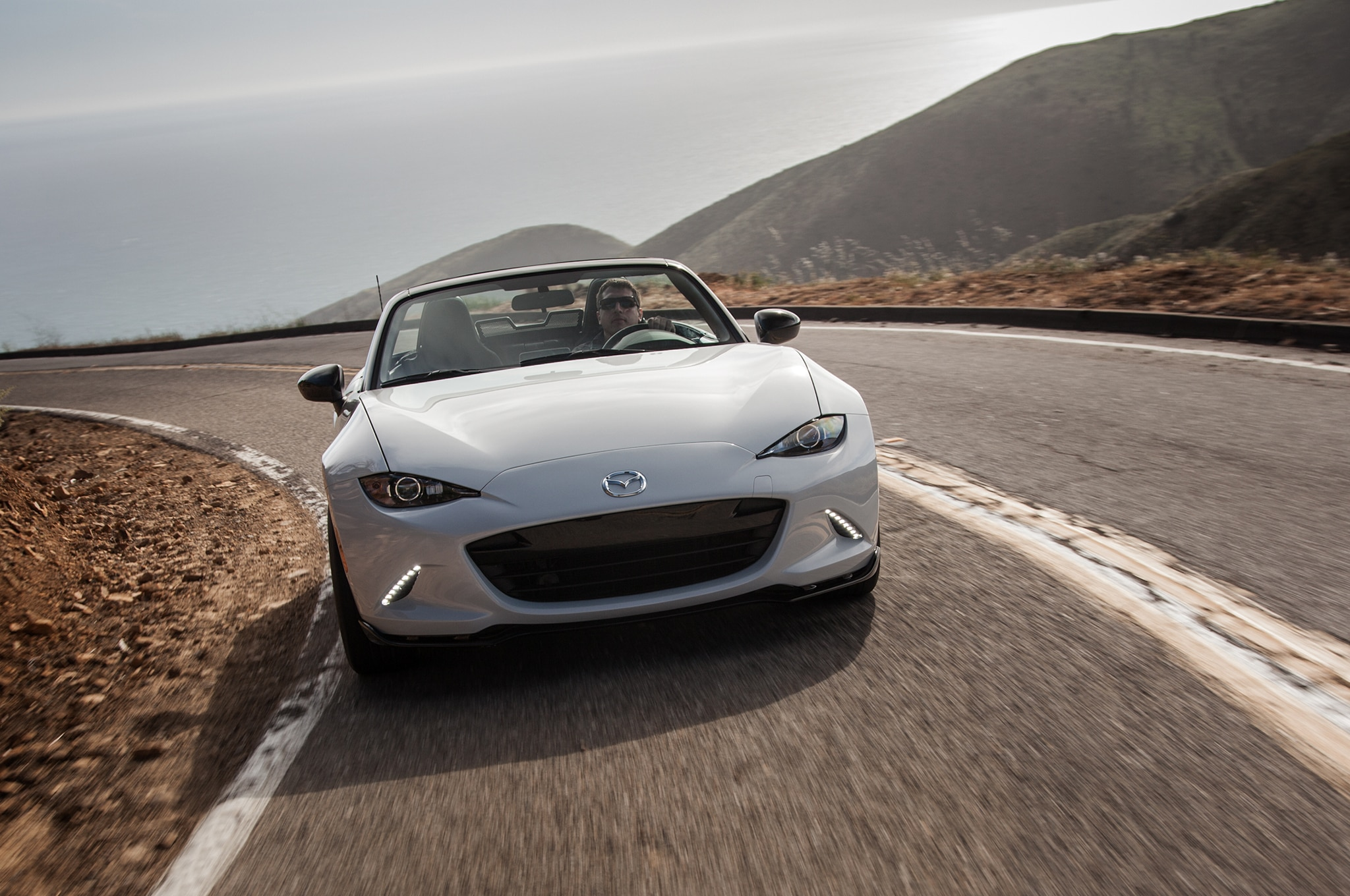 http://st.automobilemag.com/uploads/sites/10/2015/09/2016-Mazda-MX-5-Club-front-view-in-motion-03.jpg