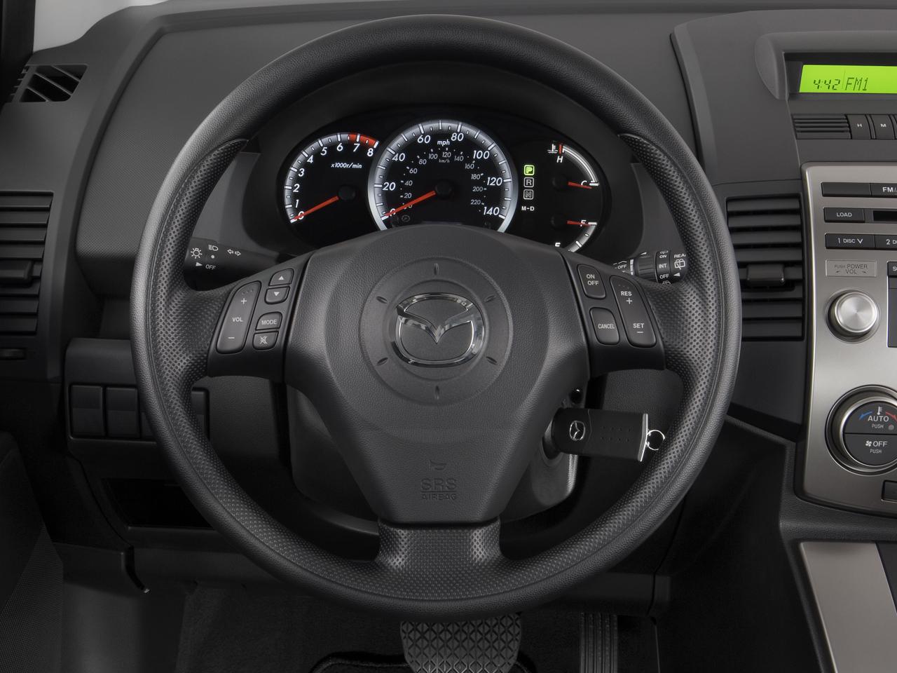 http://st.automobilemag.com/uploads/sites/10/2015/11/2008-mazda-mazda5-sport-wagon-steering-wheel.png
