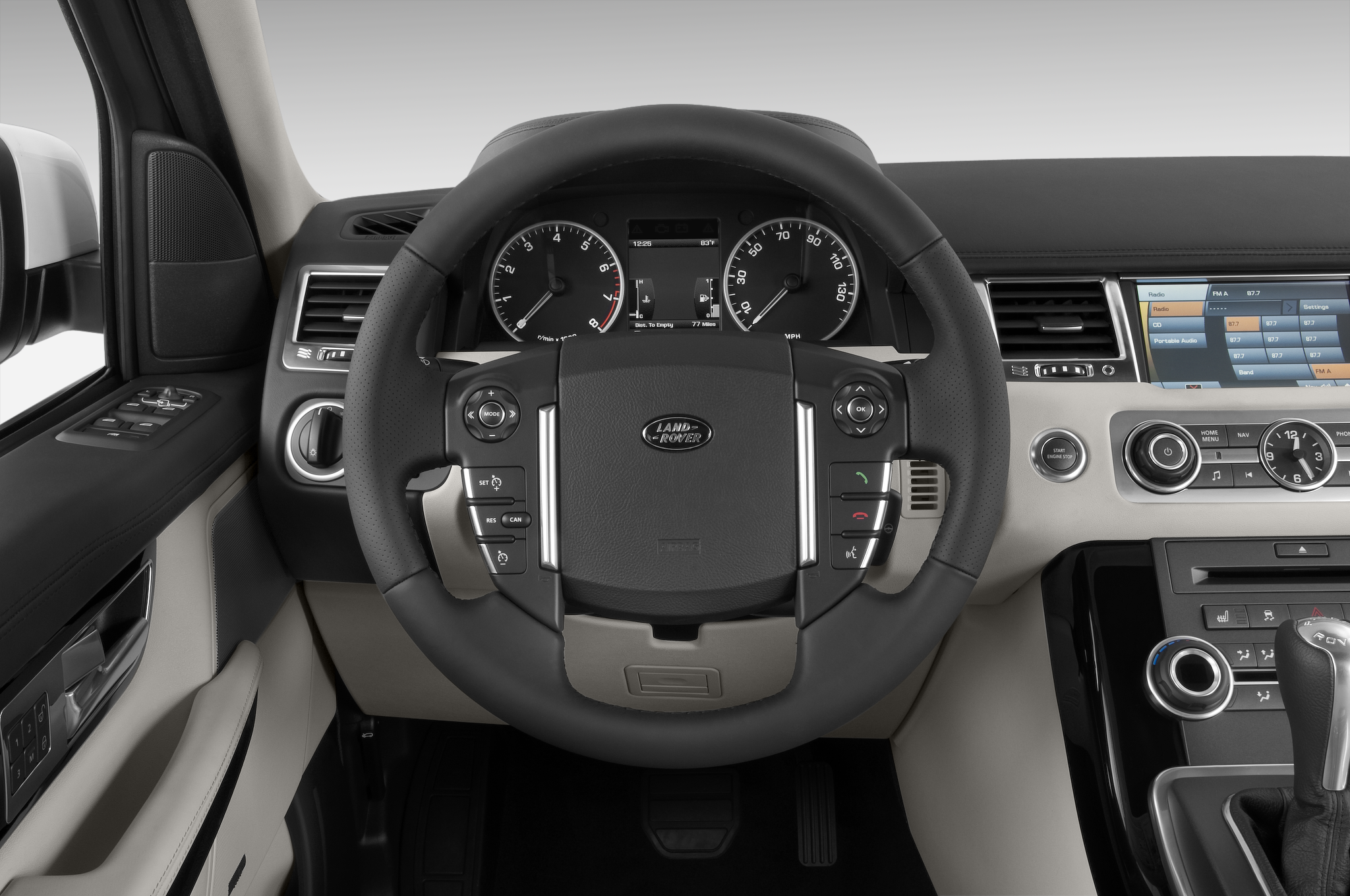 http://st.automobilemag.com/uploads/sites/10/2015/11/2010-land-rover-range-rover-sport-hse-suv-steering-wheel.png