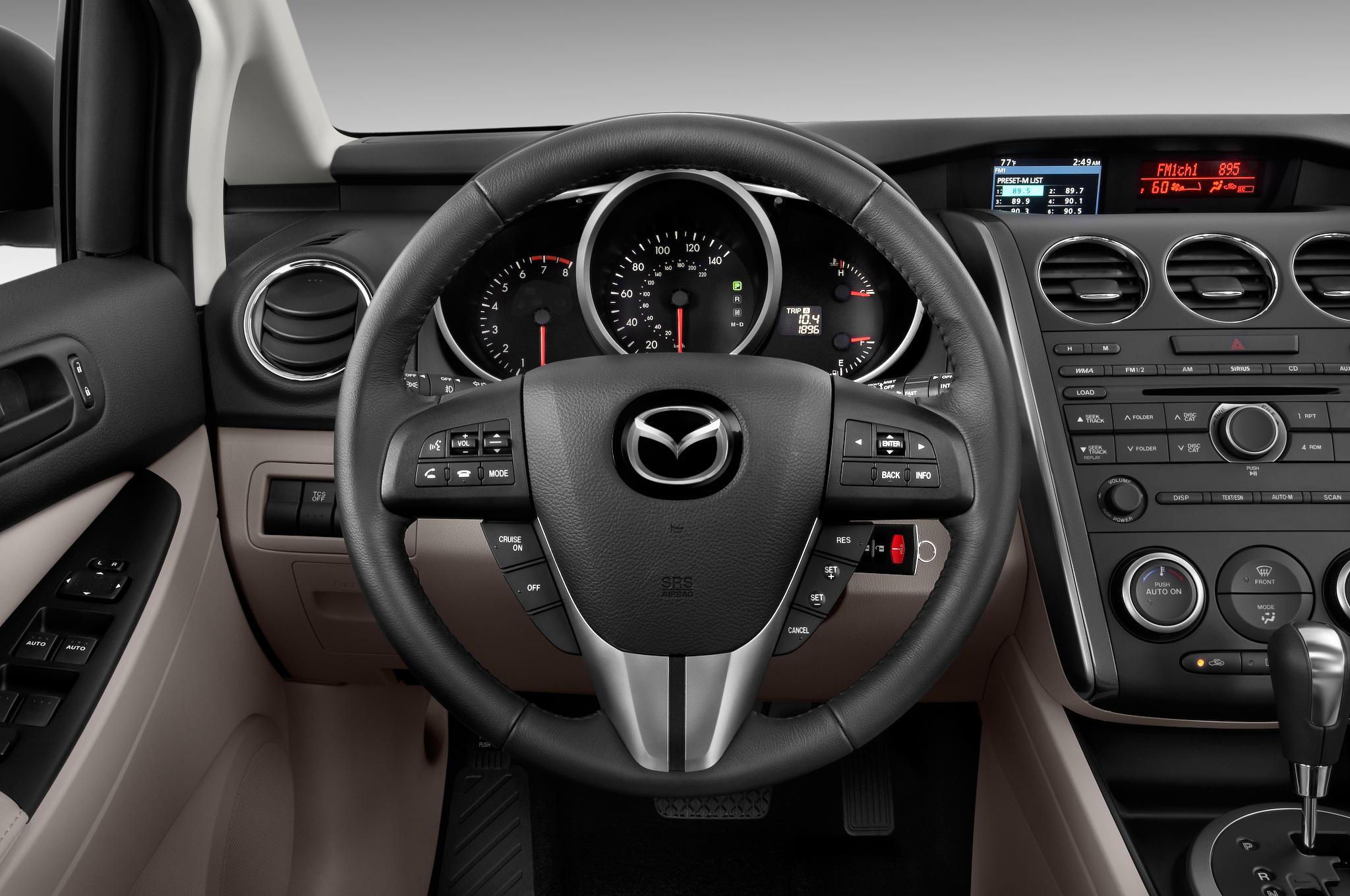 http://st.automobilemag.com/uploads/sites/10/2015/11/2010-mazda-cx7-i-sport-suv-steering-wheel.png