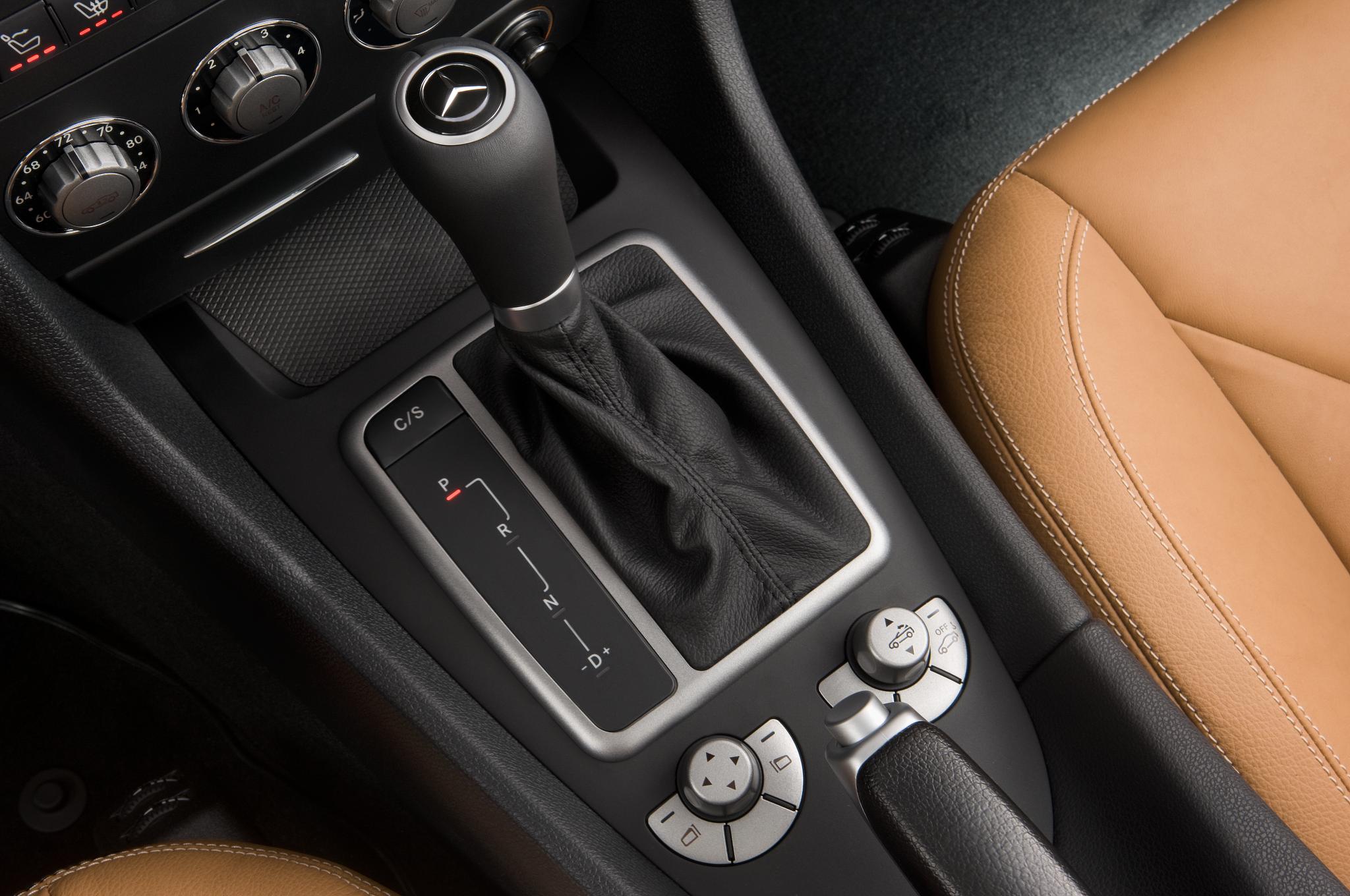 Bmw z4 sdrive35is vs mercedes benz slk350 comparison for Mercedes benz gloves
