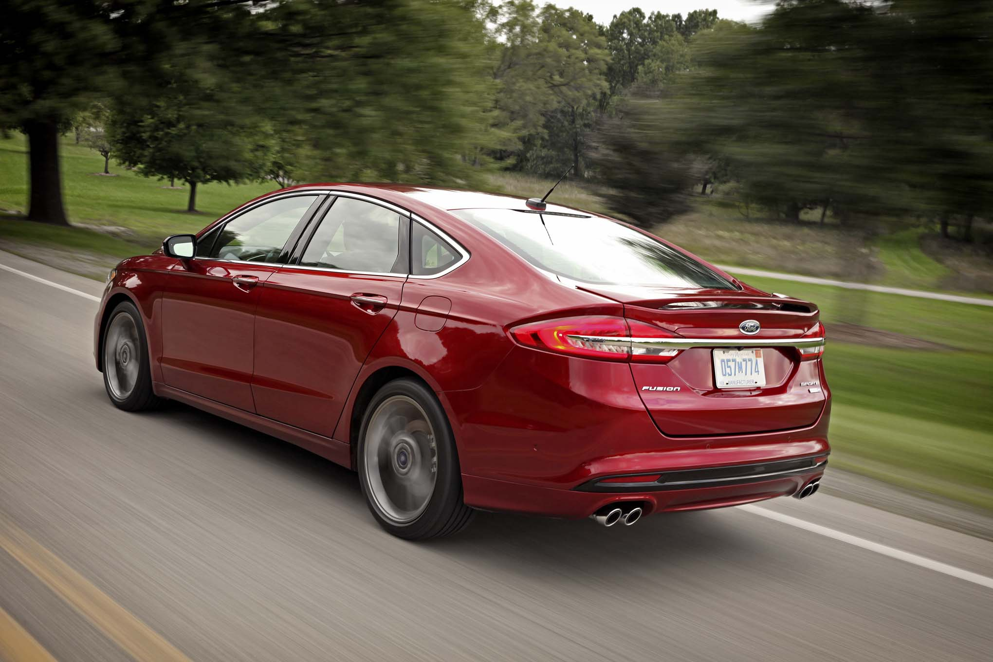 2017 Ford Fusion Sport rear three quarter in motion watch the 2017 ford fusion automatically avoid potholes  at crackthecode.co