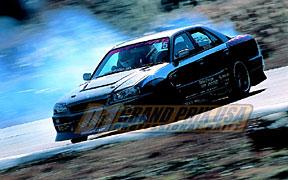 Ken Nomura in a Nissan Skyline sedan.