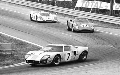 The racing rivalry that almost wasn't: A Ford GT40 leads a Ferrari 250LM at Le Mans in 1969, with a Porsche 917LH close behind.