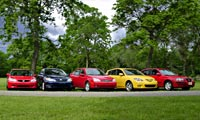 0408_Compactspl_Economy_Cars Ford_Focus_ST_And_Mazda_3_And_Honda_Civic_EX_And_Toyota_Corolla_XRS_And_Hyundai_Elantra Various_Front_Views