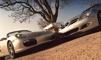 0502_pl 2005_Porsche_Boxster_And_2005_Mercedes_Benz_SLK350 Front_View