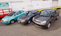 0504 Supereconopl Superecono Comparo Chevrolet Aveo And Toyota Echo And Hyundai Accent Various Front Views