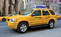 0607_pl 2006_ford_escape_hybrid_taxi Left