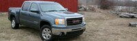 0904 04 Pl 2009 GMC Sierra 4WD Hybrid Crew Cab Front Three Quarters View