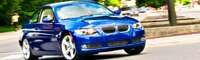 0907 07 Pl 2009 BMW 335i Coupe Front Three Quarter View