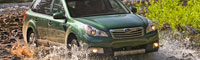 0908_01_pl 2010_subaru_outback Front_three_quarters_view_in_mud