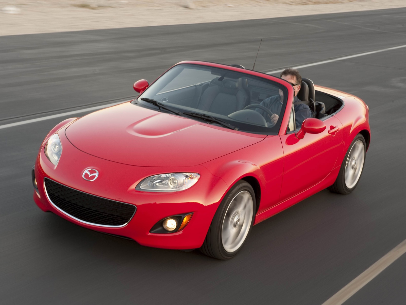 0911 03 Z 2010 Mazda MX 5 Miata Grand Touring Front Three Quarter View