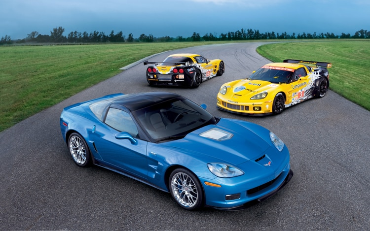 1003 01 Z 2010 Corvette ZR1 And Corvette C6R ALMS Race Cars Front Three Quarter View