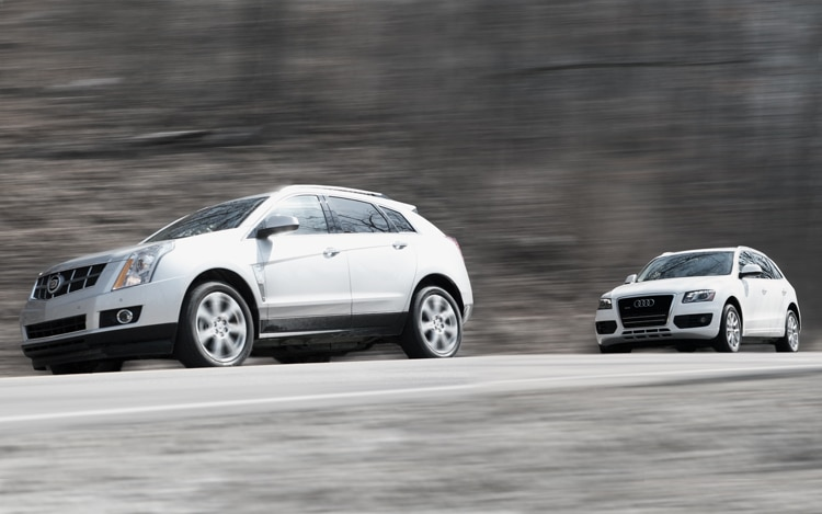 1003 01 Z 2010 Cadillac SRX And 2010 Audi Q5 Front Three Quarter View