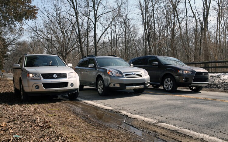 1003 01 Z 2010 Subaru Outback Mitsubishi Outlander Suzuki Grand Vitara Front Three Quarter View