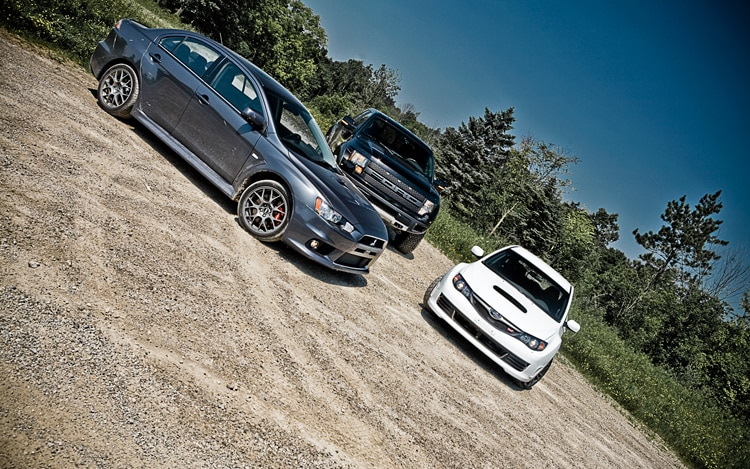 Mitsubishi Lancer Evolution Subaru WRX STI Ford F150 Raptor Front Static 2
