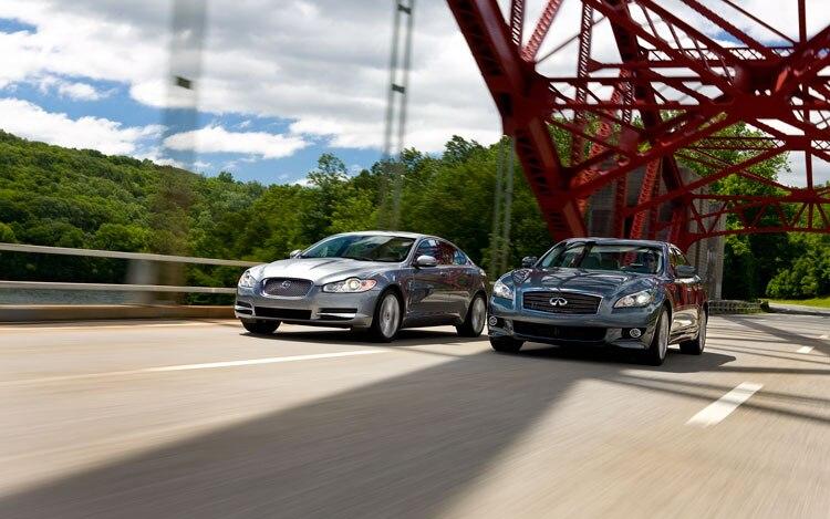 2011 Infiniti M56 Sport 2010 Jaguar Xf Premium Front Three Quarters In Motion