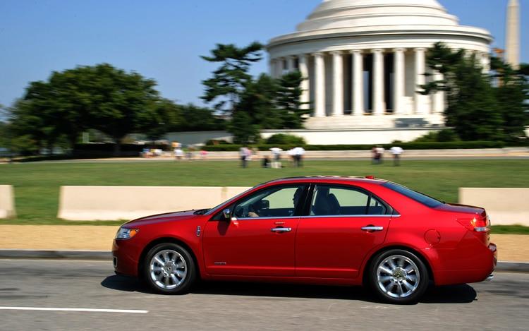 http://st.automobilemag.com/uploads/sites/11/2010/12/2011-lincoln-MKZ-hybrid-side-driver.jpg