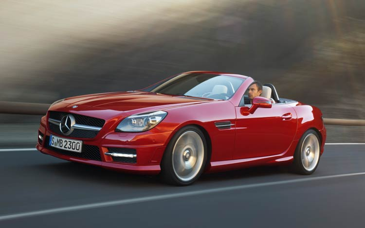 2012 Mercedes Benz SLK Front Three Quarters With Top Down In Motion1
