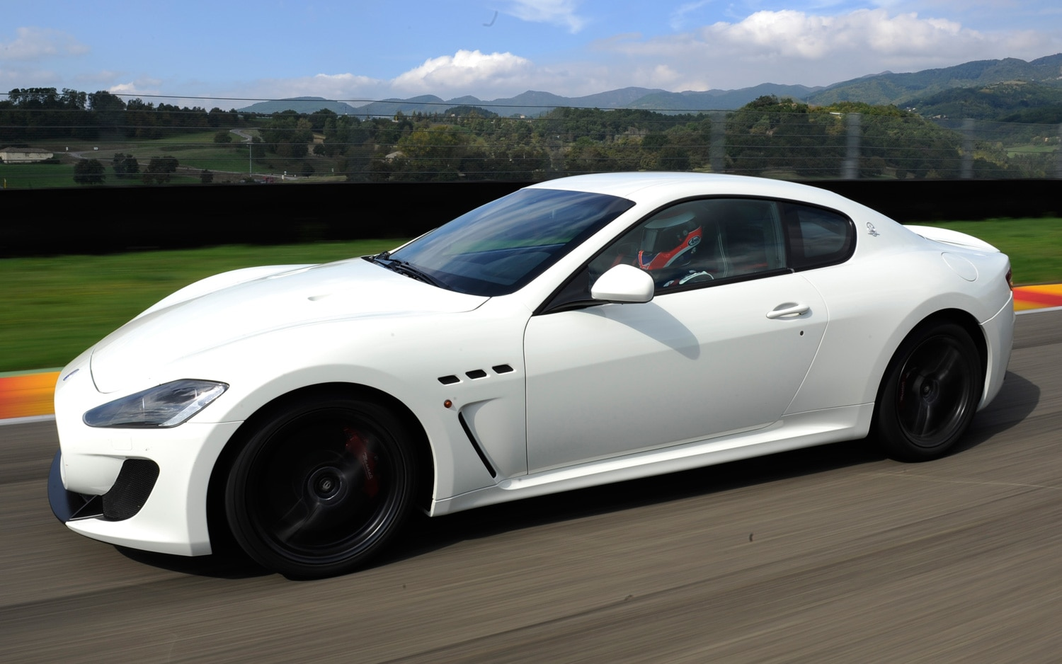 2012 Maserati GranTurismo MC Drivers Side In Motion1