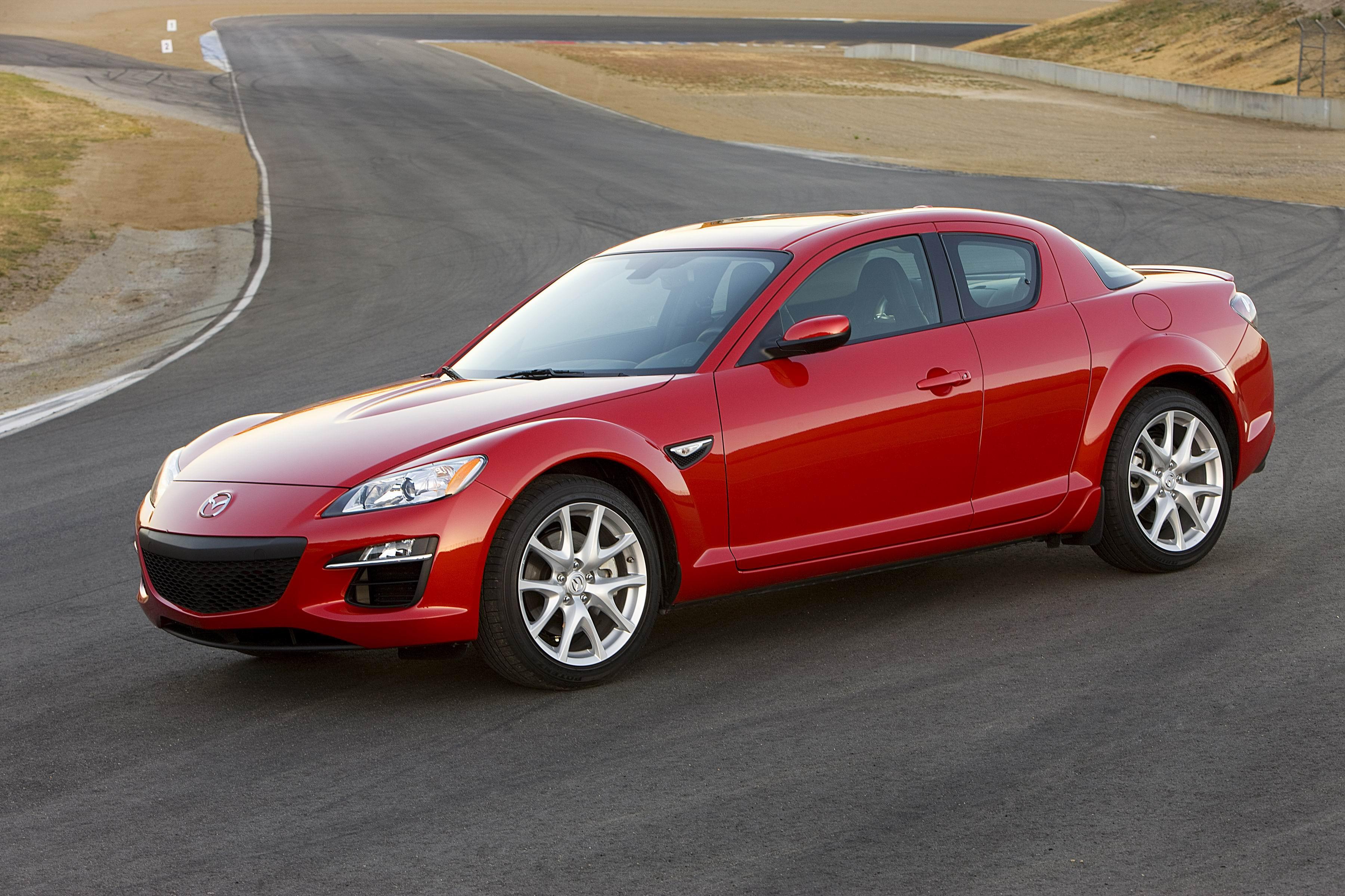 Модель rx-8 выпускалась с 2003 по 2011 год и оснащалась роторными двигателями мощностью