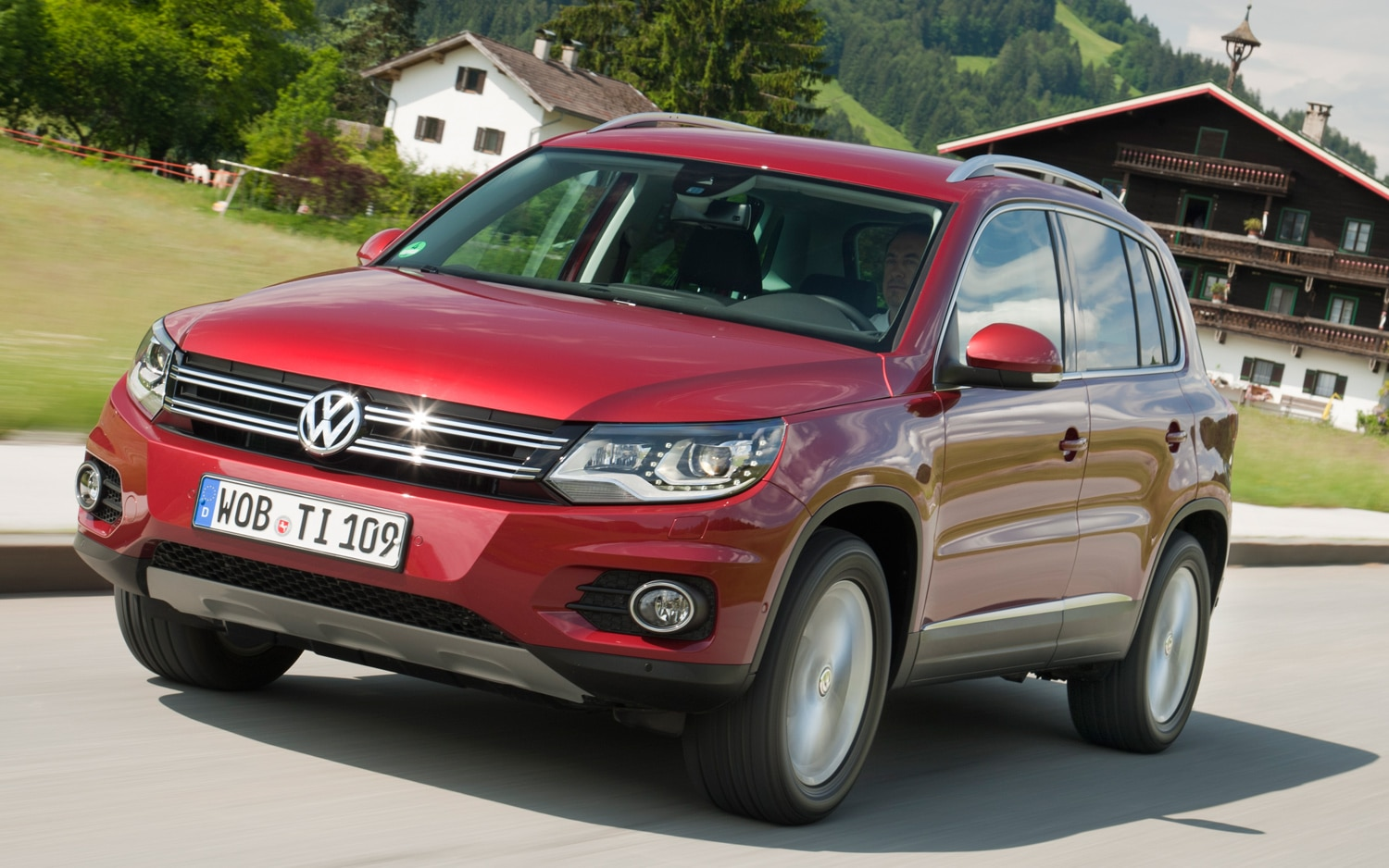 2012 Volkswagen Tiguan Drivers Side Front Three Quarters In Motion