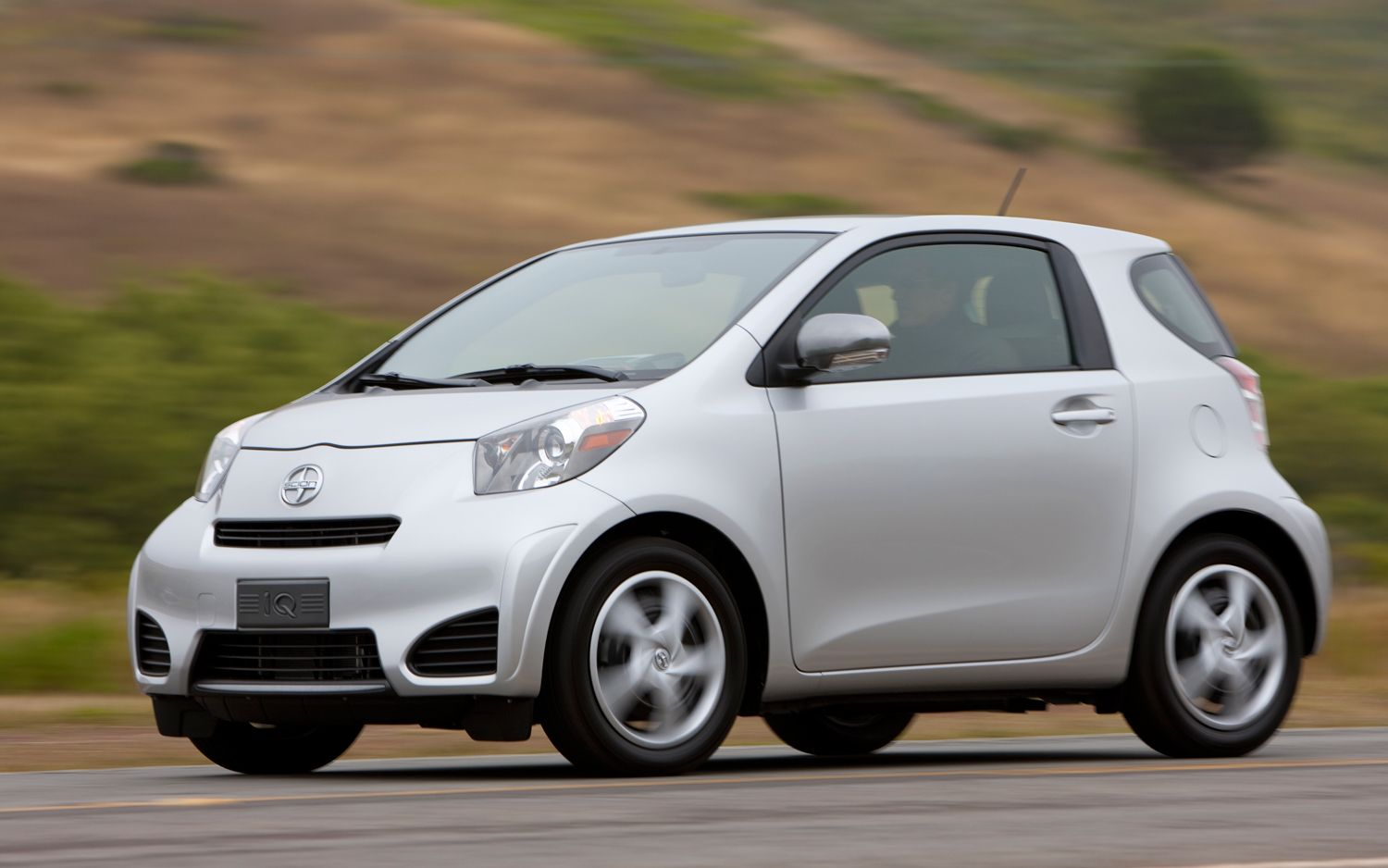 2012 Scion IQ Drivers Side Front Three Quarters In Motion