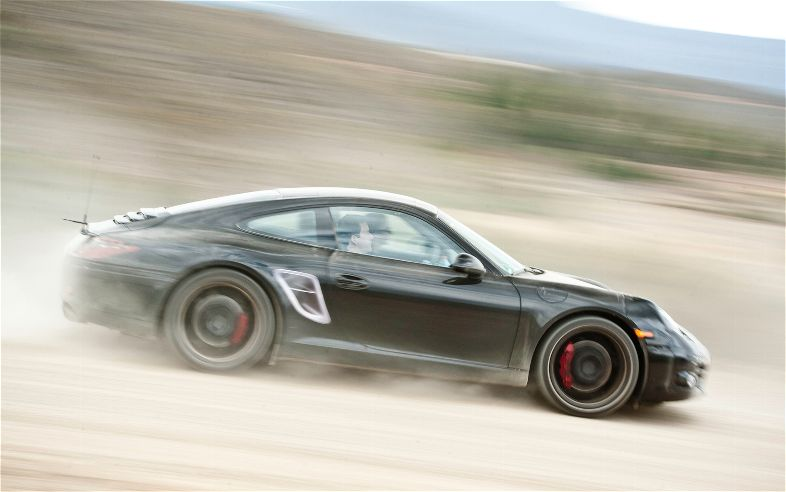 2012 Porsche 911 Side In Motion 2