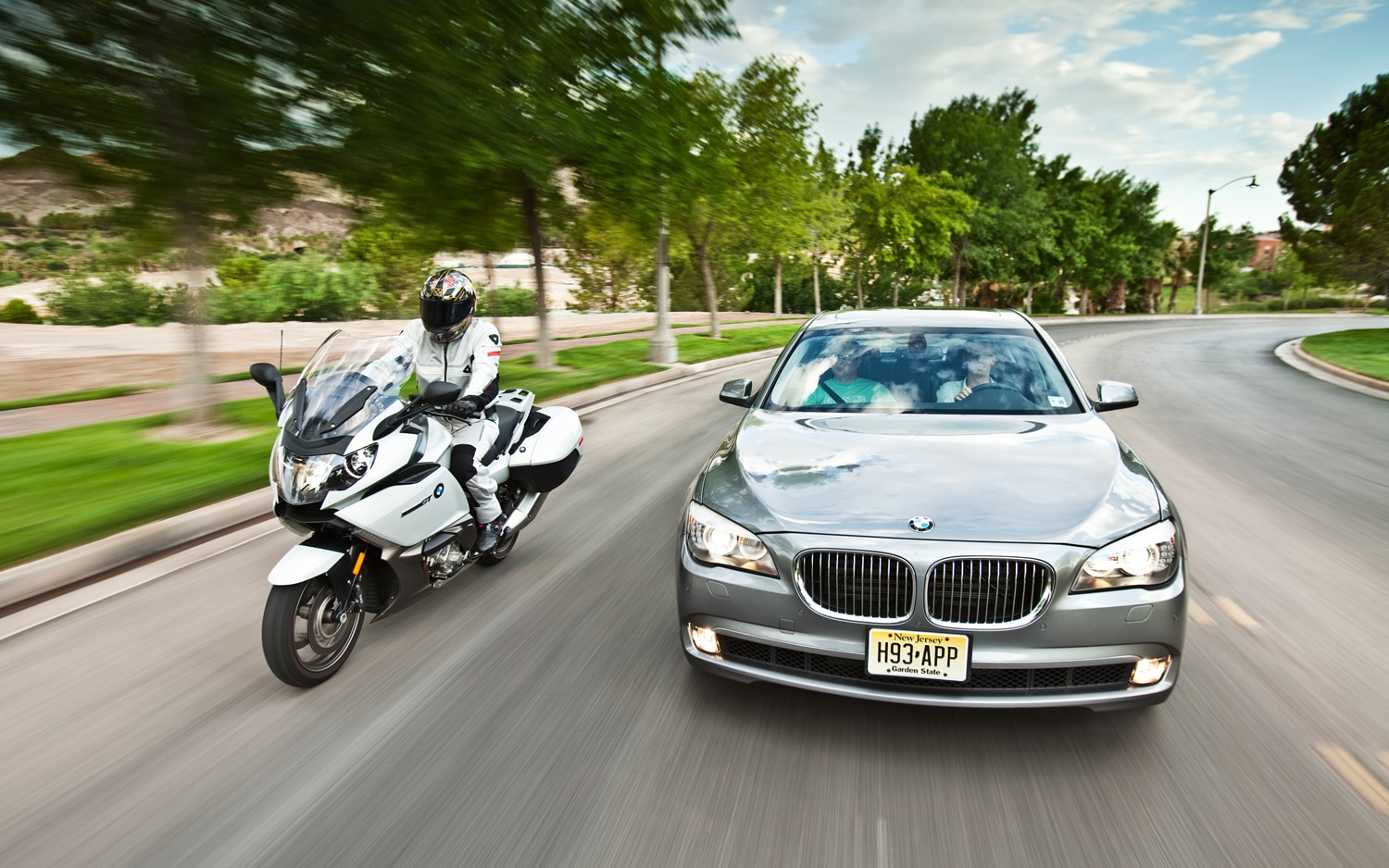 BMW 740i And BMW K1600GT Front View Driving
