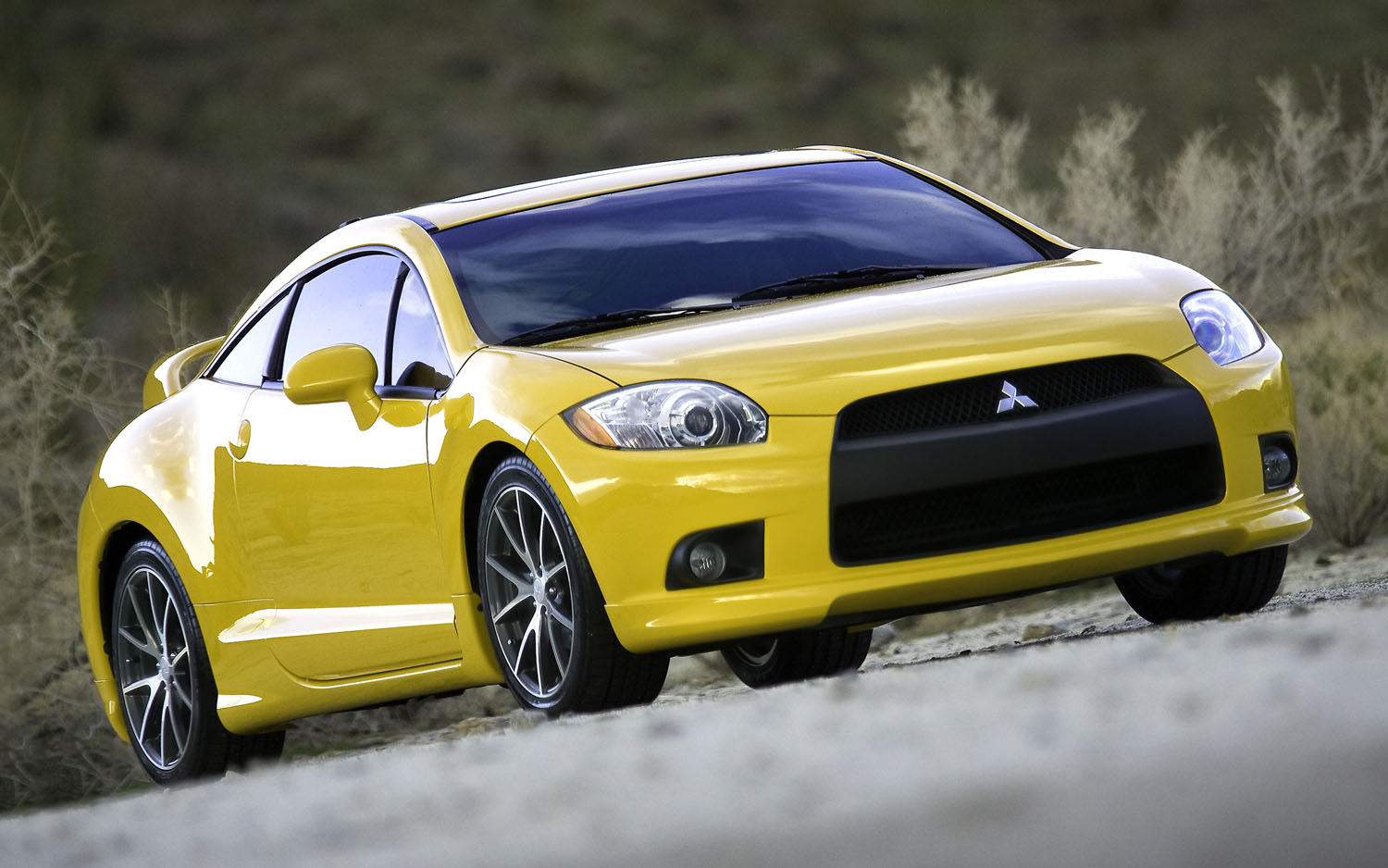 http://st.automobilemag.com/uploads/sites/11/2011/09/2010-Mitsubishi-Eclipse-GT-front-three-quarter.jpg