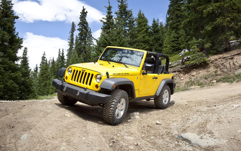 2011 Jeep Wrangler Front Three Quarter Yellow V21