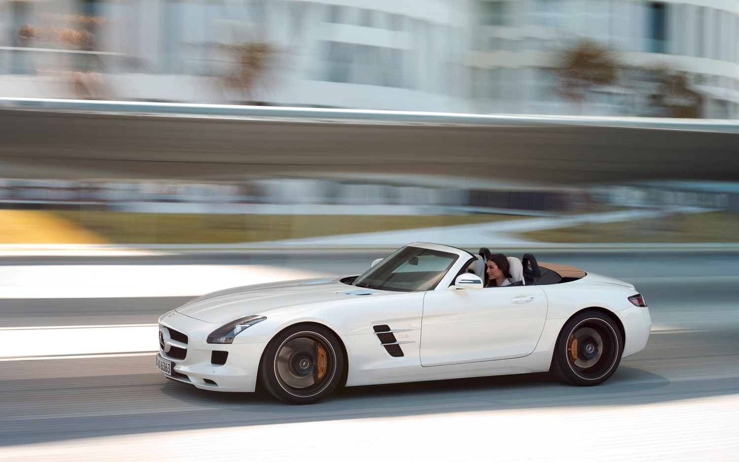2012 Mercedes Benz SLS AMG Roadster Side In Motion 22