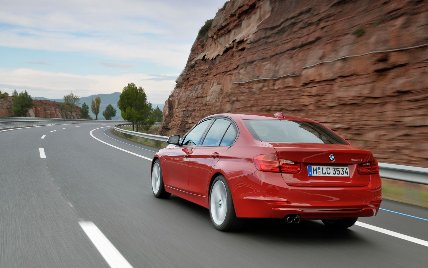2012 BMW 3 Series Rear Three Quarters In Motion1