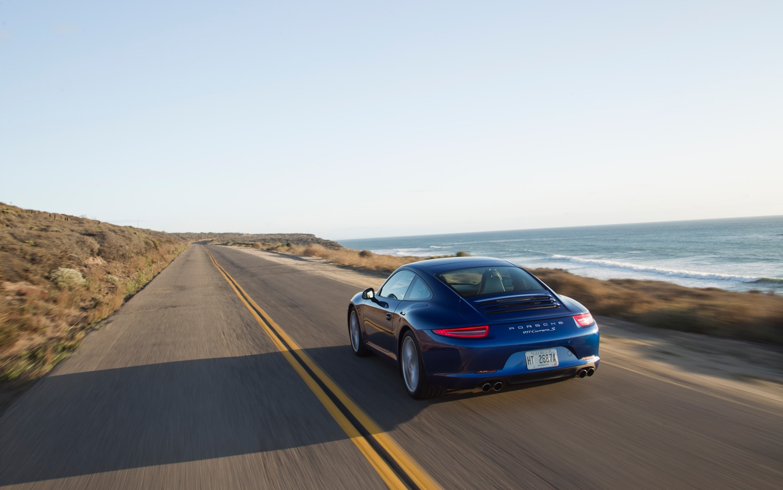 2012 Porsche 911 Carrera S Aqua Blue Rear In Motion1
