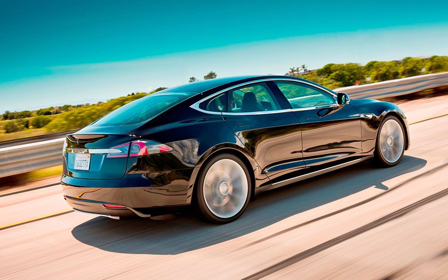 2012 Tesla Model S Rear Three Quarters In Motion1