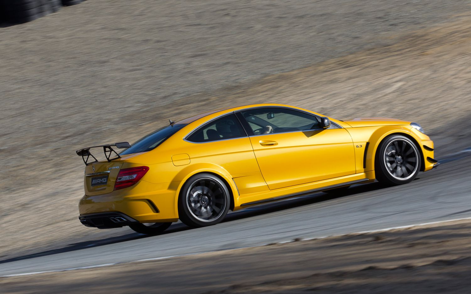 2013 Mercedes Benz C63 AMG Coupe Black Series Side In Motion 21