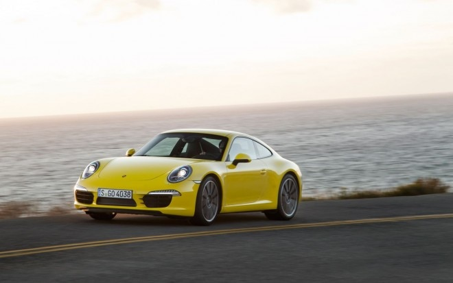 2012 Porsche 911 Carrera S Racing Yellow Front Three Quarters In Motion11 660x413