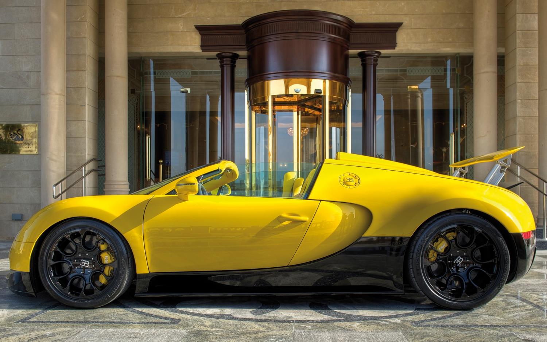 bugatti reveals bright yellow veyron grand sport in qatar. Black Bedroom Furniture Sets. Home Design Ideas