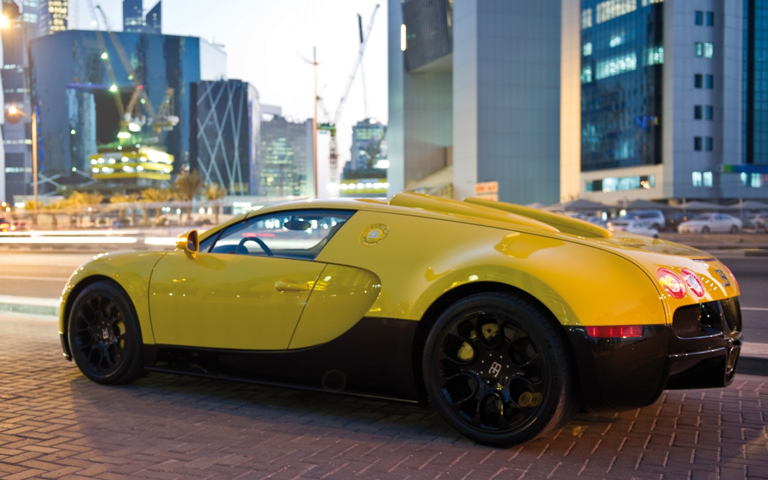 bugatti reveals bright yellow veyron grand sport in qatar. Black Bedroom Furniture Sets. Home Design Ideas