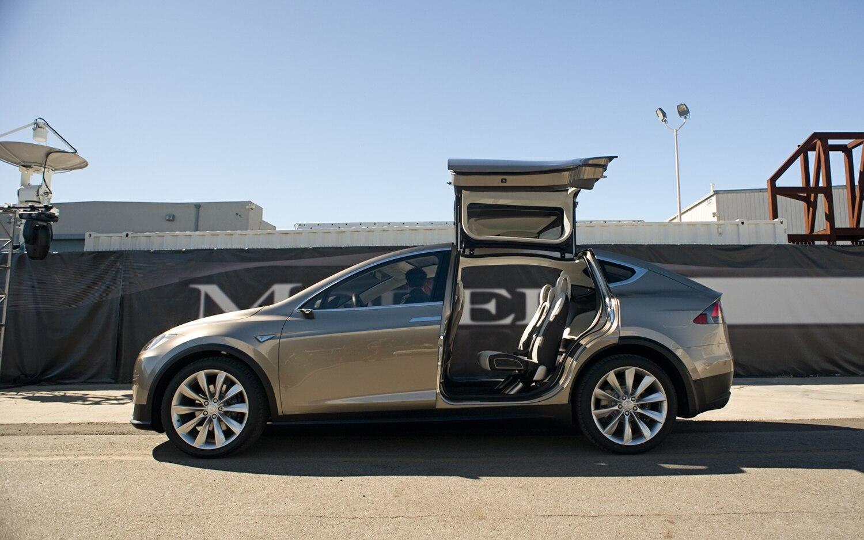 tesla model x prototype crossover revealed with falcon door fixation. Black Bedroom Furniture Sets. Home Design Ideas