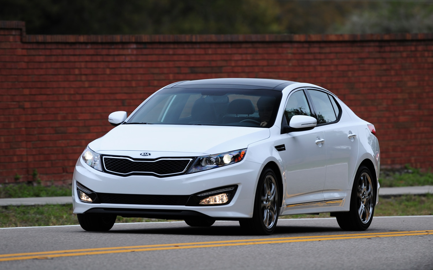 2012 Kia Optima Limited Front Three Quarter In Motion2
