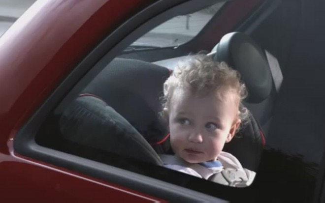 Baby In Back Seat Of Fiat 5001 660x413